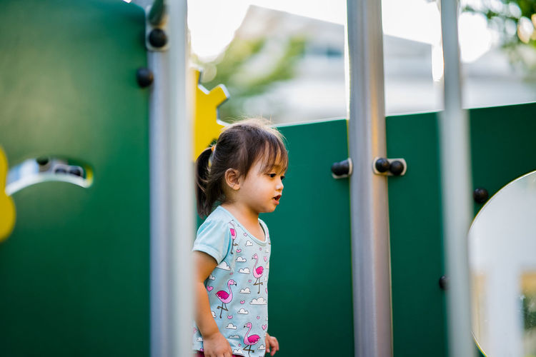 Girl standing on play equipment