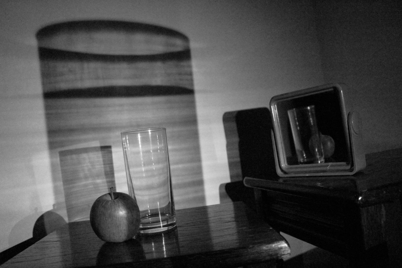 Apple And Drinking Glass On Table