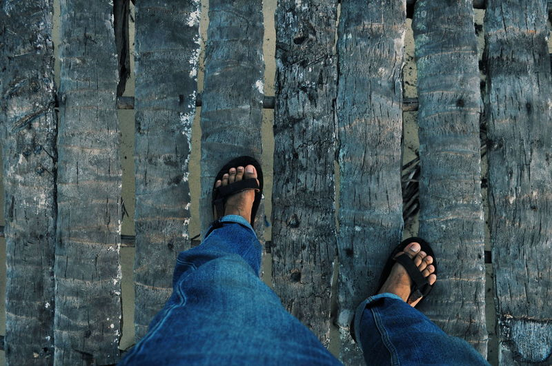 Low Section Men Standing Human Leg Directly Above Shoe Blue Jeans Personal Perspective Footwear Human Feet Human Foot Ground