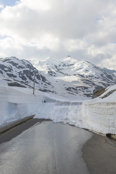 Mountain Road with Snow Beauty In Nature Blocked Road Close Cold Temperature Day Landscape Mountain Mountain Road Nature No People Outdoors Road San Bernardino Scenics Sky Snow Snow Wall Snow-capped Street Street Culture Swiss Alps Switzerland Tranquil Scene Tranquility Winter