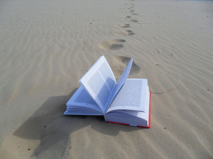 open book in the sand Minimalism Minimal Nature Open Book  Open Books Book Beach Sand Water Close-up Sand Dune Ocean Horizon Over Water Arid Climate Sea Seascape Literature Bookstore Library Hardcover Book Bookshelf My Best Photo 17.62° The Minimalist - 2019 EyeEm Awards