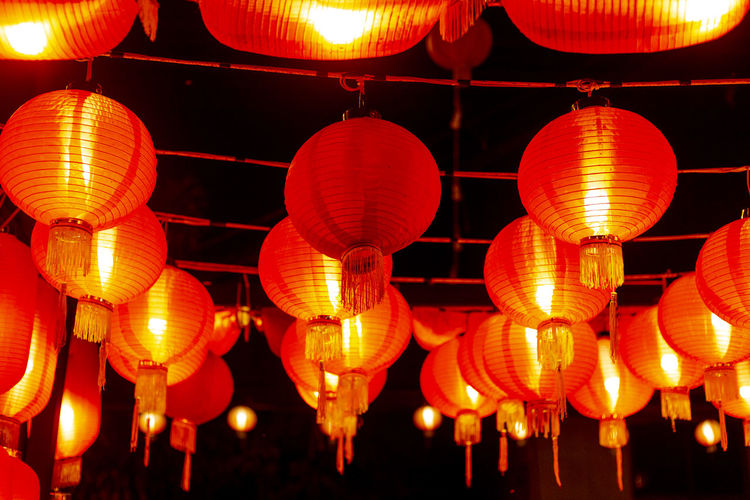 Red lanterns at night Lighting Equipment Illuminated Hanging Chinese Lantern Lantern Decoration Low Angle View Night No People Traditional Festival Large Group Of Objects Festival In A Row Chinese New Year Chinese Lantern Festival Repetition Celebration Electricity  Outdoors Light Red Lump Red Lanterns China
