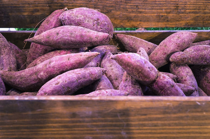 Close-up Day Food Food And Drink For Sale Freshness Healthy Eating Large Group Of Objects Market Purple Purple Potatoes Purple Yam Raw Potato Raw Potatoes Retail  Root Vegetable Stack Supermarket Sweet Potatoes Vegetable Vegtable Box Vegtables Yam