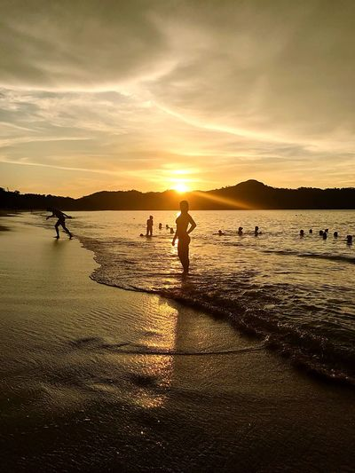 Lost In The Landscape Water Sunset Beach Sky Nature Beauty In Nature Sea Silhouette Scenics Cloud - Sky Sand Real People Outdoors Lifestyles Sunlight Vacations Mountain Costa Rica Conchal EyeEm Best Shots Honeymoon Full Length Day Relaxation