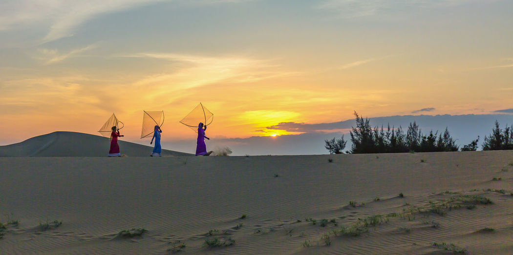 Cham women Beauty In Nature Sunset