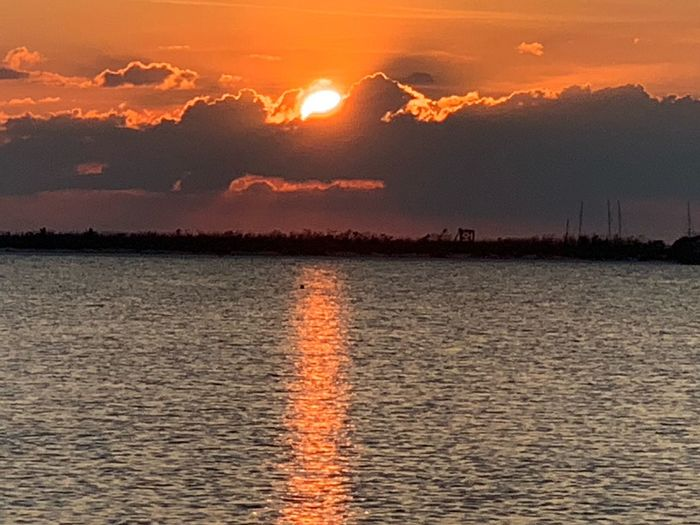 Sunset Sky Beauty In Nature Water Scenics - Nature Cloud - Sky Tranquility Nature Tranquil Scene Orange Color Sun Environment No People Reflection Idyllic Sunlight Sea Outdoors Romantic Sky