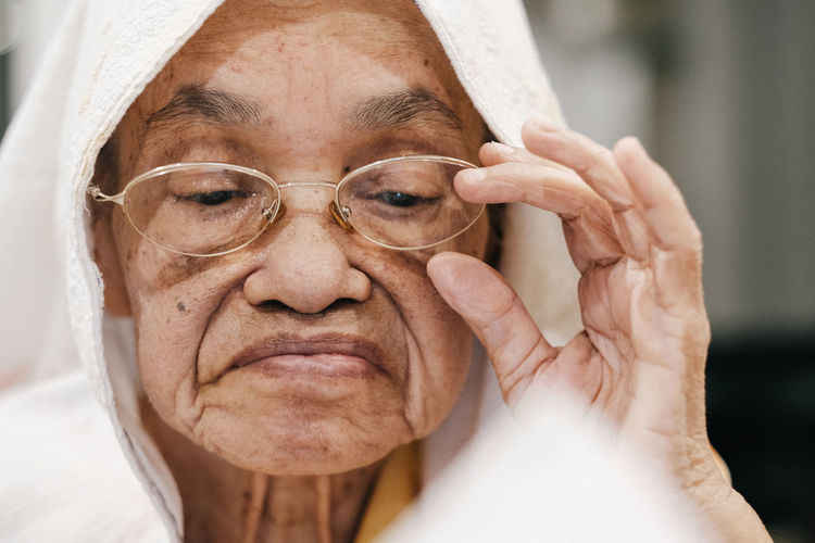 Close-up of senior woman with eyeglasses
