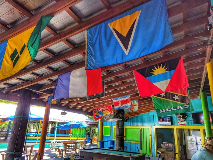 IsLaNd BeAcH bAr Multi Colored Architecture Low Angle View Built Structure Travel Destinations Building Exterior No People Outdoors Day Sky Flag Ocean VirginIslands Scenics