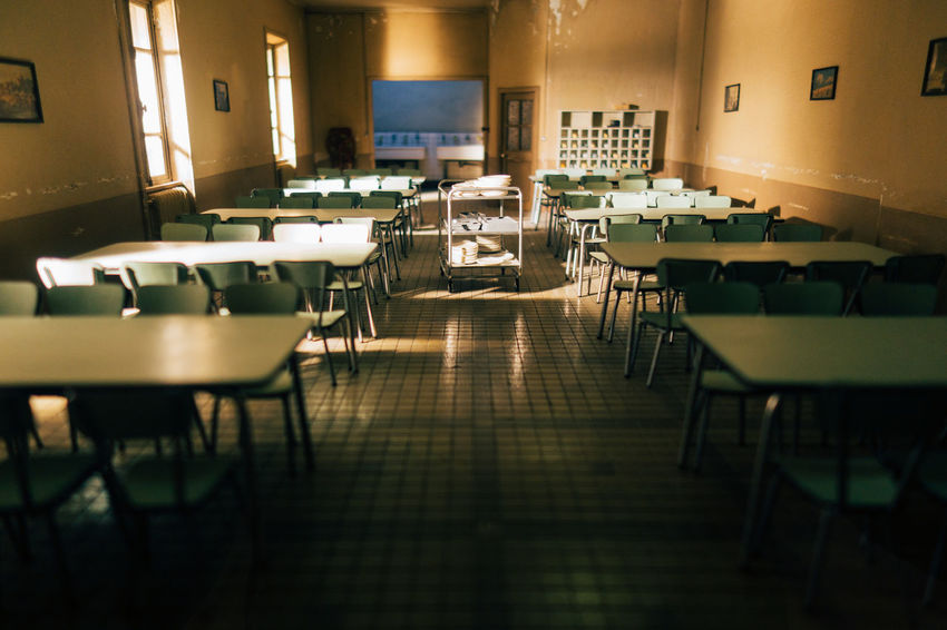 Canteen Dining Hall Dining Area Table Seat Chair Old Vintage Room Interior Absence Empty Furniture Classroom Illuminated School Education Architecture Indoors  Desk No People In A Row Building Learning Lighting Equipment Flooring Built Structure Cafeteria Electric Lamp