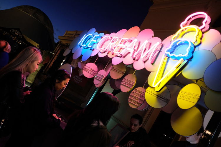 Fun Colorful Communication Food And Drink Group Of People Ice Cream Illuminated Lifestyles Low Angle View Night Pink And Blue Real People Women The Street Photographer - 2019 EyeEm Awards