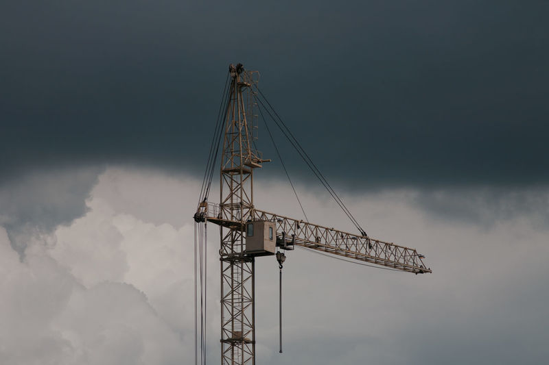 Tower crane in the cloudy sky Tower Crane Cloud - Sky Construction Equipment Construction Industry Construction Machinery Crane Crane - Construction Machinery Industrial Equipment Industry Machinery Metal No People Sky Tall - High