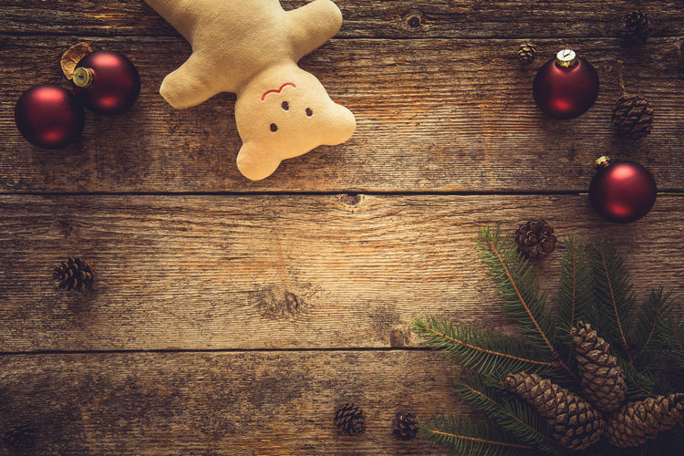 High Angle View Of Christmas Decoration And Teddy Bear On Table