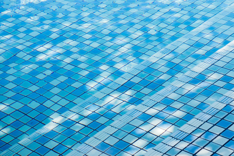 Texture of water surface, surface of blue swimming pool,background of water in swimming pool. Abstract Aqua Background Blue Bottom Bright Clean Color Decoration Empty Floor Flow  Fresh Fun Healthy Holiday Hotel Leisure Light Liquid Nobody Outdoor Pattern Pool Reflection Relax Relaxation Resort Ripple Sport Stair Staircase Stairs Steps Style Summer Sunlight Surface Swim Swiming Swimming Texture Textured  Tile Tiles Underwater Wallpaper Water Wave Wave*pool