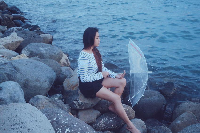 Solemn. Asiangirl Feels VSCO NikonD3100 Umbrella Women Of EyeEm Week On Eyeem Asianlook Cinematography Woman Seaside Philippines