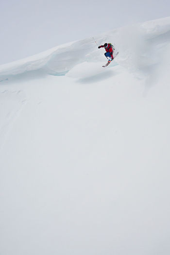 Person skiing on snow covered mountain