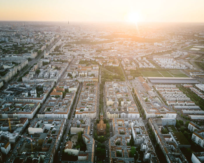 Alexanderplatz Church DJI X Eyeem From Above  Hope Spirituality TV Tower Aerial View Architecture Built Structure City City Life Cityscape Day Dronephotography High Angle View Modern Office Building Exterior Religion Skyscraper Sun Sun Flare Sunrise Sunset Warm Light