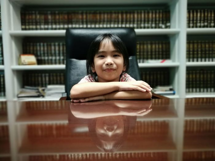 Portrait of a girl on book Childhood One Person Portrait Lifestyles Elementary Age Leisure Activity Indoors  Girls Book Headshot Library Day Close Up Real People Front View Looking At Camera Huaweiphotography Huawei Huawei P10 Plus Children Photography Child Child Portrait Leica Lens EyeEmNewHere