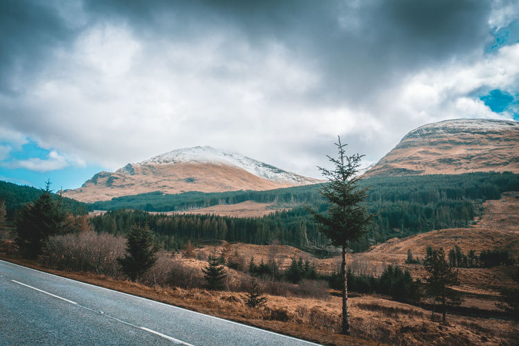Scotland Beauty In Nature Cloud - Sky Day Landscape Mountain Mountain Range Nature No People Outdoors Road Scenics Sky Tranquil Scene Tranquility Tree
