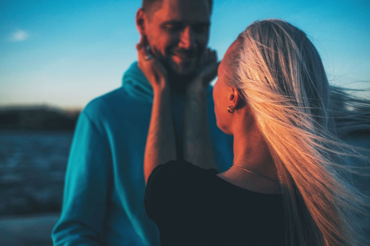 Couple in love on the pier, sunset time, water background Two People Togetherness Women Adult Young Adult Lifestyles Young Women Emotion People Bonding Hair Real People Long Hair Love Hairstyle Sky Leisure Activity Positive Emotion Couple - Relationship Beautiful Woman