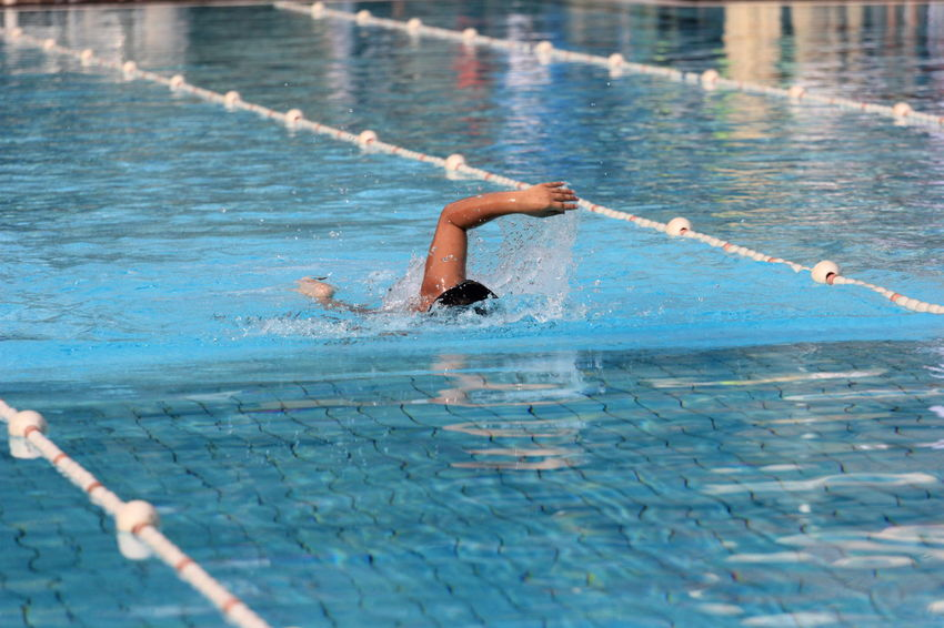 "Autism Olympic Game Indonesia 2017, The class game ""swimming competition"" Second Acts Adult Adults Only Athlete Competition Competitive Sport Day Exercising Human Body Part Human Hand Men One Man Only One Person Only Men Outdoors People Real People Sport Sports Race Sportsman Strength Swimming Swimming Lane Marker Swimming Pool Water Young Adult"