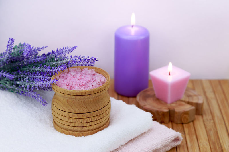 sea salt on a wooden table in the bathroom, concept - body care Nobody No People Massage Massage Therapy Bath Candle Natural Pink Salt Wellness Bathroom Beauty Care Crystal Freshness Health Healthy Indoors  Ingredient Mineral Organic Pampering Purple Sea Spa Towel Towels Treatment White Wooden Toiletries