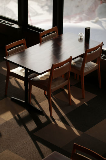 Light and Shadow Absence Architecture Chair Day Desk Empty Flooring Food And Drink Furniture Indoors  Light And Shadow Nature No People Seat Setting Shadow Sunlight Table Window Wood - Material