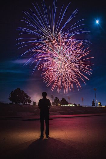 Be. Ready. Fireworks Silhouette Illuminated Night Standing Real People One Person Full Length Firework Display Firework - Man Made Object Sky Celebration Multi Colored Long Exposure Outdoors Lifestyles Arts Culture And Entertainment Firework Wireless Technology Men One Man Only EyeEmNewHere