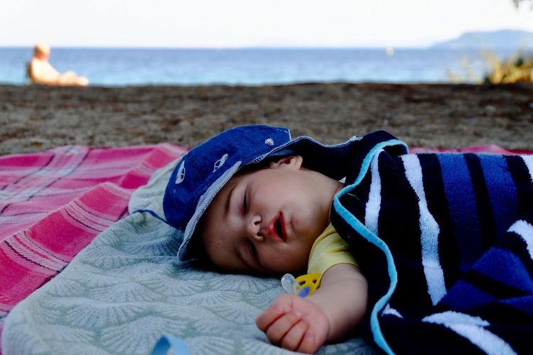 Cute Baby Boy Sleeping At Beach