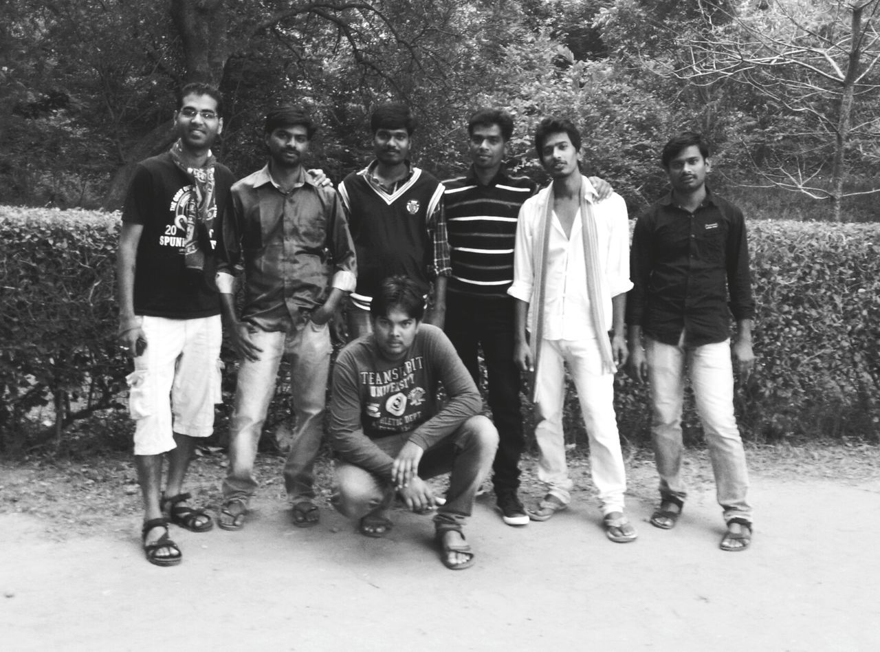 full length, tree, outdoors, boys, day, young men, men, togetherness, young adult, real people, young women, nature, adult, people