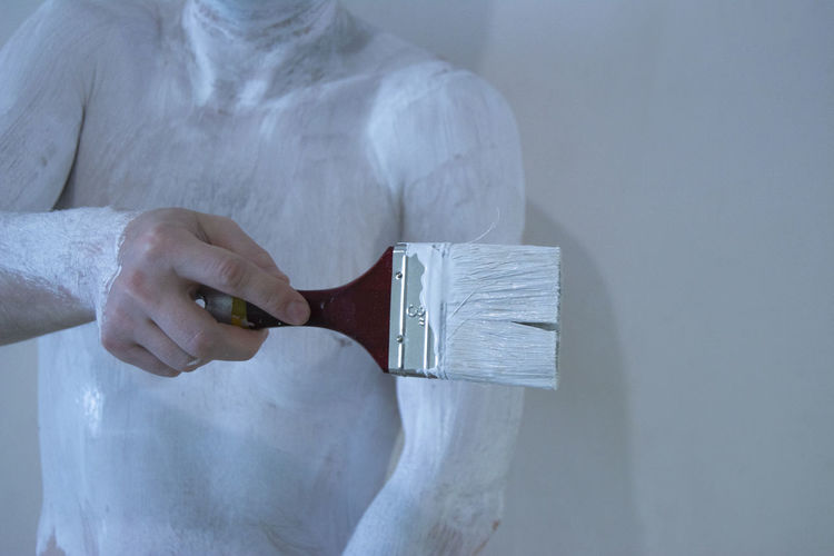 Hand Human Hand Holding One Person Human Body Part Midsection Indoors  Close-up Adult Front View Focus On Foreground White Color Tassel Paint Paintings Color Dye Stain Color Body Paint Body Paint Body Painting Art White Background White Colored Brush Paint Brush Creativity