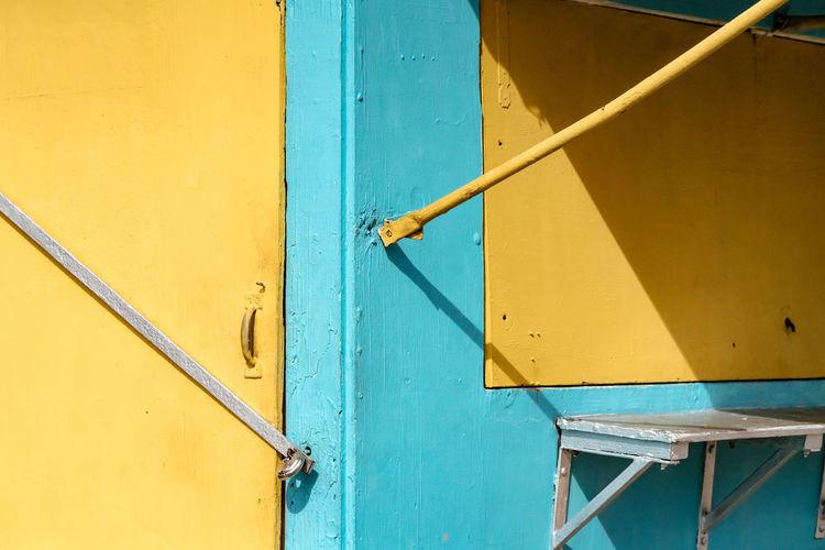 Full frame shot of ladder against yellow wall