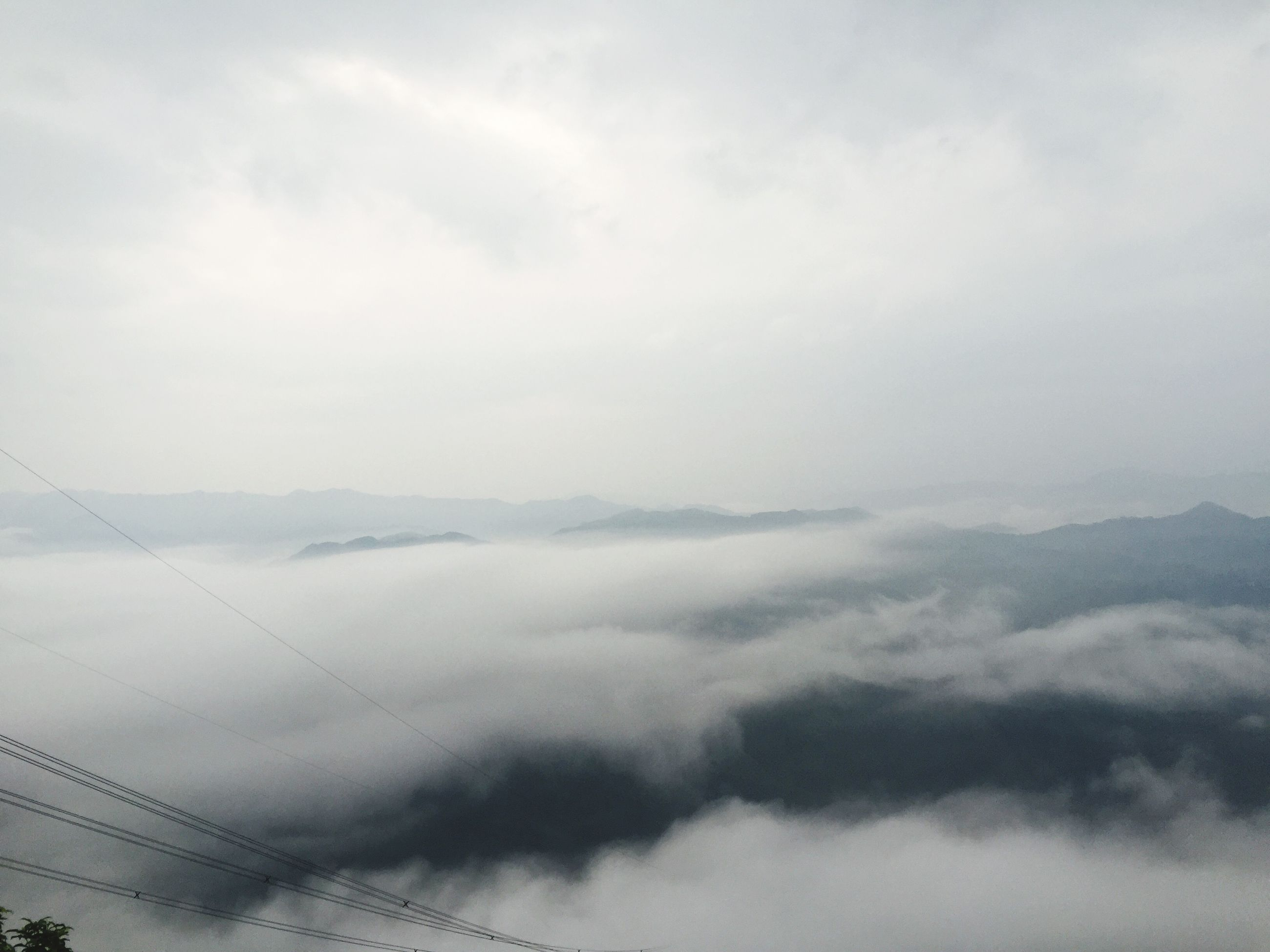 sky, cloud - sky, cloudy, tranquility, scenics, tranquil scene, beauty in nature, weather, nature, cloudscape, cloud, low angle view, white color, day, outdoors, no people, overcast, idyllic, fog, landscape