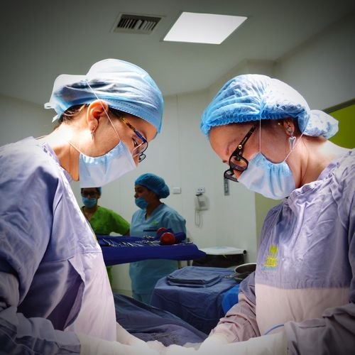 Healthcare And Medicine Surgical Mask Hygiene Teamwork Doctor  Protective Workwear Looking Down Hospital Working Surgical Cap Uniform Professional Occupation