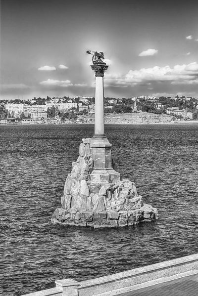 Sunken ships memorial, iconic monument and landmark in Sevastopol, Crimea Architectural Column Architecture Art And Craft Building Exterior Built Structure Cloud - Sky Day Human Representation Nature No People Outdoors Sculpture Sea Sky Statue The Past Travel Travel Destinations Water Waterfront