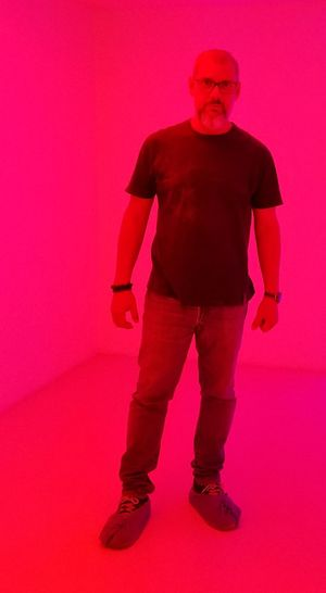 I'm Red Full Length Portrait Standing Pink Background Red Studio Shot Working Colored Background Men Weapon Magenta Dahlia Bougainvillea Foundry Welder Ominous Formal Portrait Astrology Sign Jack O Lantern THREATS Stoke On Trent Metal Industry Steel Worker Steel Mill Blacksmith
