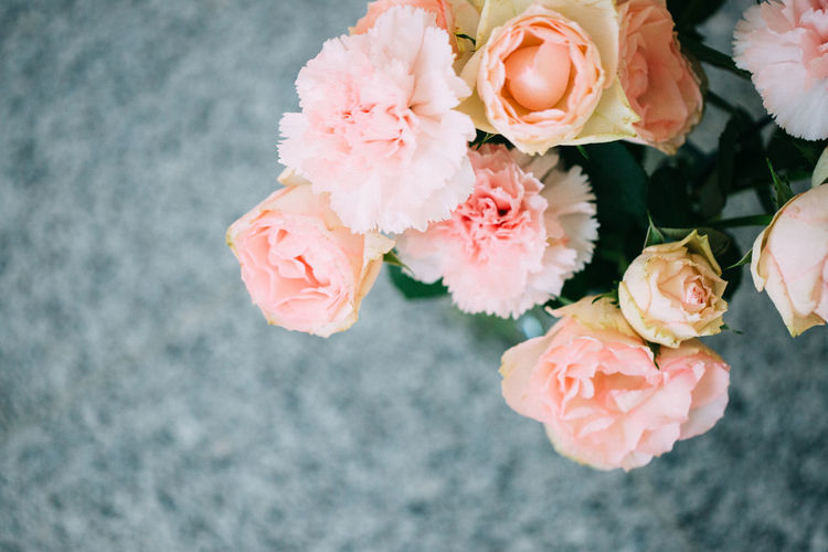 Peach coloured flowers ( carnations and roses) in a vase. Beauty In Nature Blooming Bud Carnation Close-up Decoration Detail Deutschland Flower Flower Head Flowers Focus On Foreground Fragility Freshness Growth München Nature Peach Color Petal Pink Color Plant Romance Rosé Simplicity Soft
