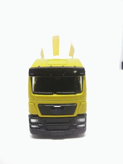 Yellow White Background Studio Shot No People Indoors  Close-up Topgear Golden Light Contractions Lorry Tracks Cemen Turck Toy Car Industry Business Finance And Industry Land Vehicle Mode Of Transport Cut Out Transportation Freight Transportation