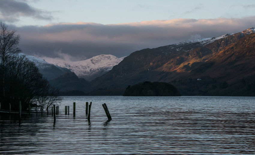 Beauty In Nature Cloud - Sky Derwentwater Early Morning Lake Landscape Mountain Mountain Range No People Non-urban Scene Scenics Sky Snowcapped Mountain Stormy Tranquil Scene Water