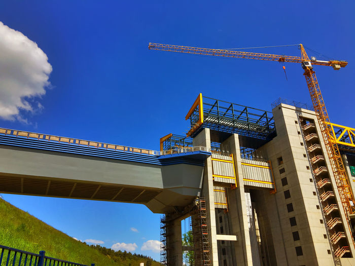 Low angle view of niederfinow boat lift against blue sky