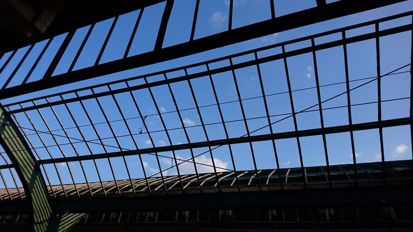 Roof construction. Oldenburg Oldenburg In Oldenburg Oldb Öl Lower Saxony Germany Hbf Hauptbahnhof Central Station Roof Train Station Roofs Glassless Frame Construction Perspective Lines Architecture Sky Blue Blue Sky From Below Low Angle View City Modern Sky Architecture Built Structure Building Exterior