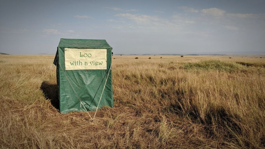 A VIP loo in the Massai Mara, also known as a packed lunch to the lions Toilet Loo Scenic Lookout Scenic Kenya Massai Mara Grass Grassland Agriculture Sky Grass Information Sign