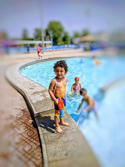My lovely son enjoy the summer Kids Child Childhood Day Full Length Hairstyle Holiday Kidsphotography One Person Pool Son Swimming Pool Swimwear Toy Vacations Water Water Gun