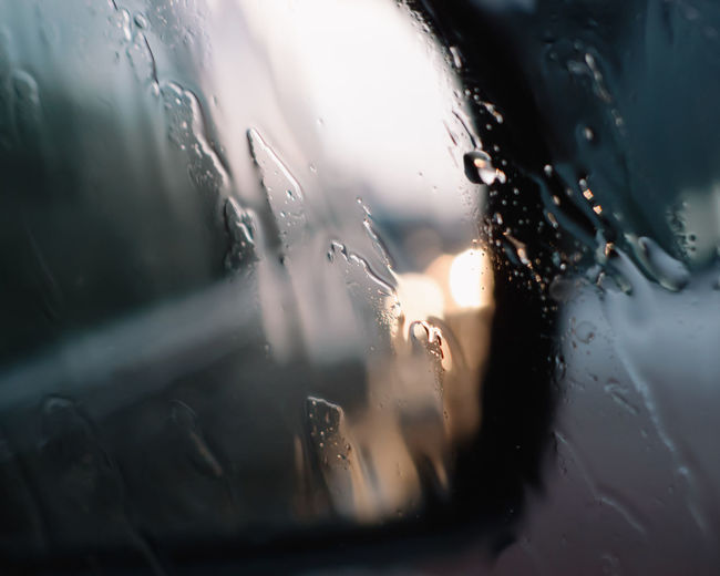Abstract Backgrounds Car Close-up Day Details Drops Land Vehicle Lights Macro Mode Of Transport No People Rain RainDrop Selective Focus Side Mirror Side Mirror View Transportation Water Wet Window