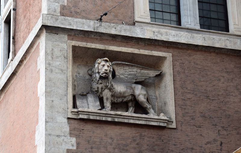 Low angle view of lion statue on building