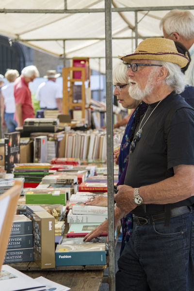 Standing by the book stall Books EventPhotography Read Second Hand Street Market Book Bookmarket Cheap Dutch Education Educational Information Outside Outside Photography Paperback Paperback Novel People People And Places Publication Reading A Book Real People Streetphotography Sunny Day Urban Vintage