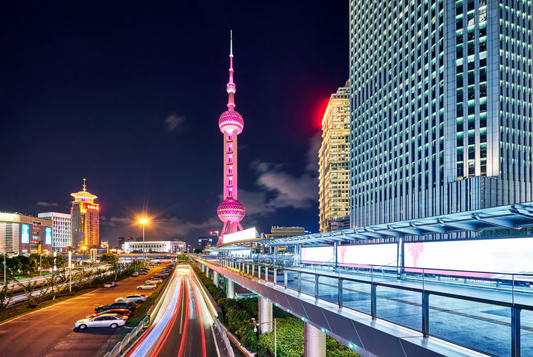 Oriental Pearl Tower Against Sky In City At Night