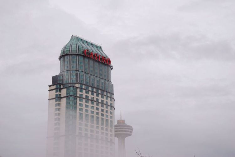 A casino in Niagara Falls. It was a beautiful morning with a lot of fog, making it very hard to see the waterfalls, but hey, at least this photo came out of it. Urban Water Fog Architecture Morning