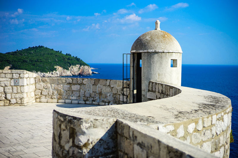 Top view of Dubrovnik, Croatia Architecture Sky Built Structure Building Exterior Water Sea Nature History The Past Day No People Wall Building Travel Destinations Sunlight Outdoors Religion Horizon Over Water Horizon Stone Wall Game Of Thrones Croatia Old Town Top View Shot