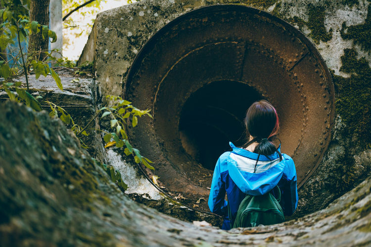 Discovering Adventure Architecture Boys Broken Built Structure Childhood Day Grunge Lifestyles Men One Person Outdoors People Pipe Pipe - Tube Real People Rear View Turbine Ussr