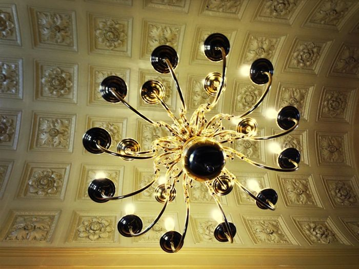 Low angle view of chandelier hanging from ceiling